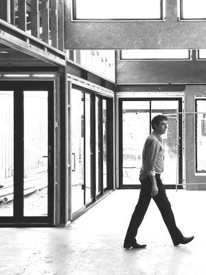 architect walking through building site