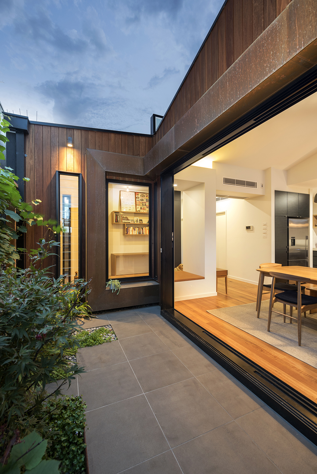 courtyard with copper feature spotted gum shiplap cladding and bluestone pavers