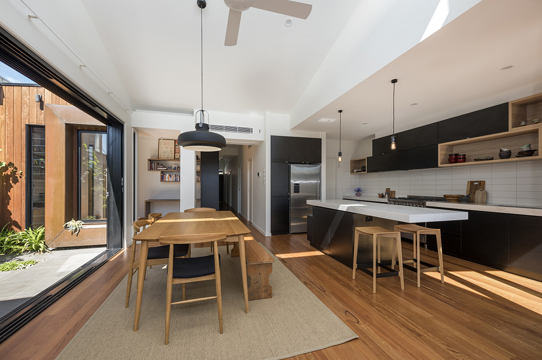 contemporary open plan kitchen dining saw tooth roof line