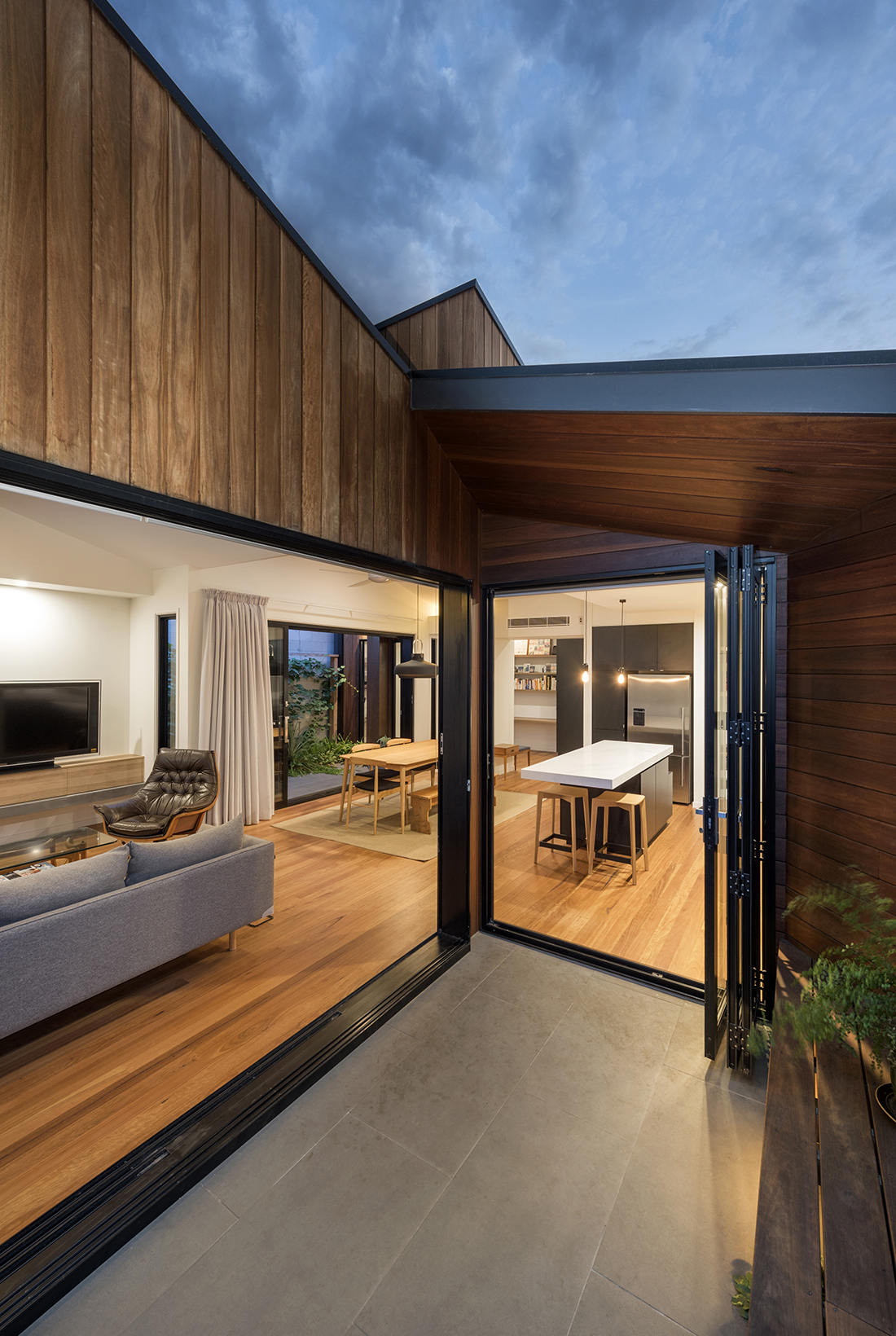 contemporary extension with shiplap cladding and black windows