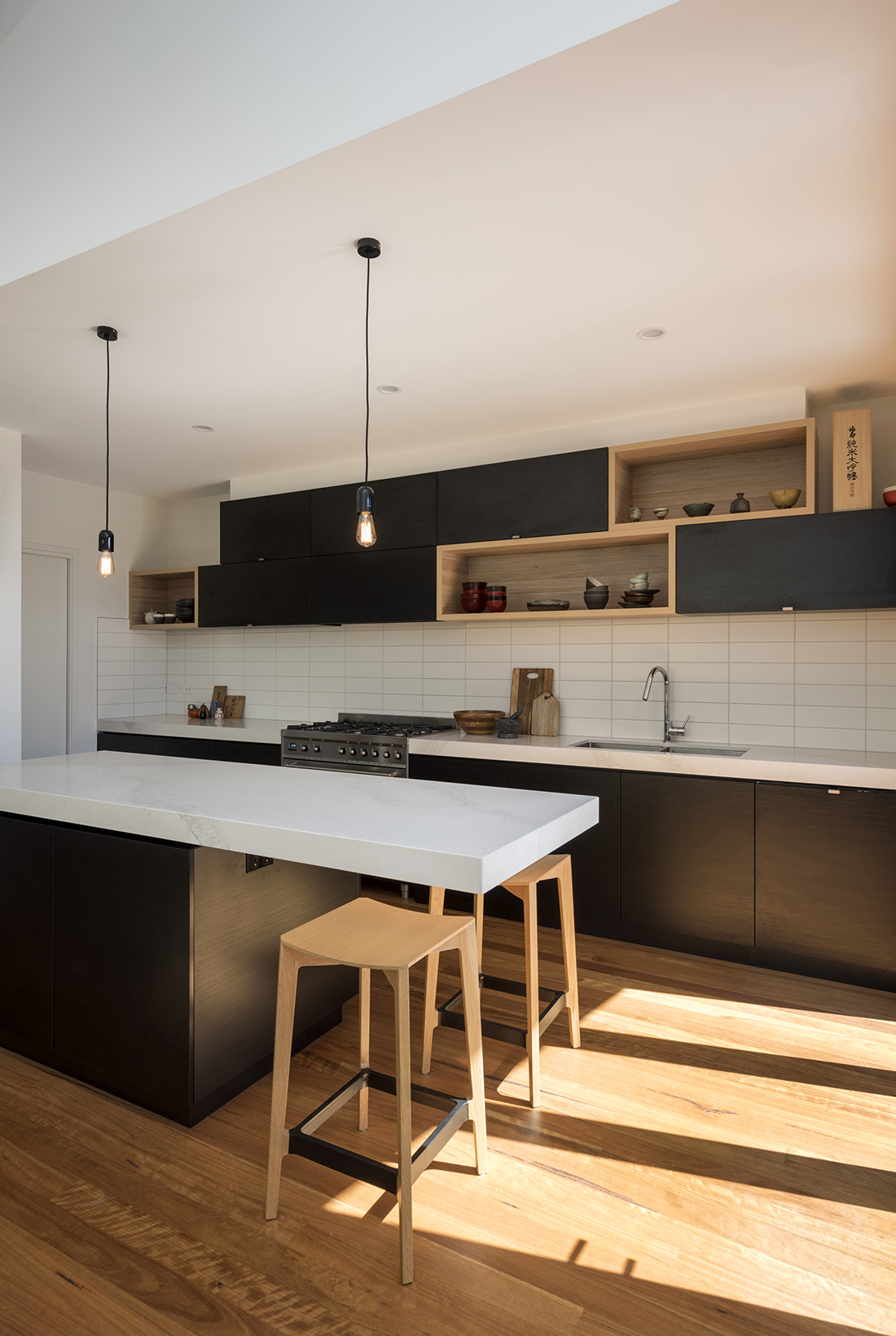 contemporary kitchen with black oak and carrara