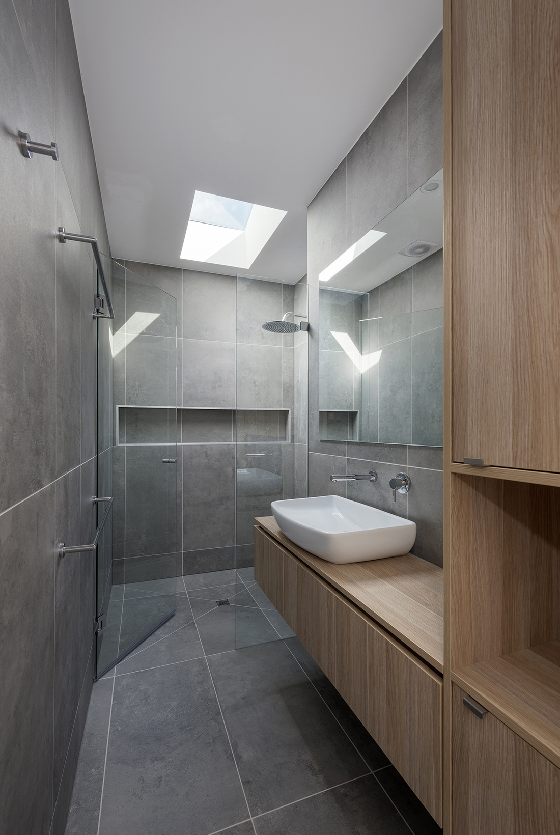 contemporary bathroom with concrete tiles oak and skylight
