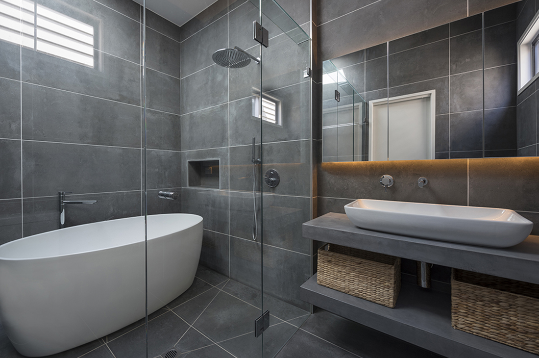 contemporary ensuite with wet room, concrete tiles and skylight