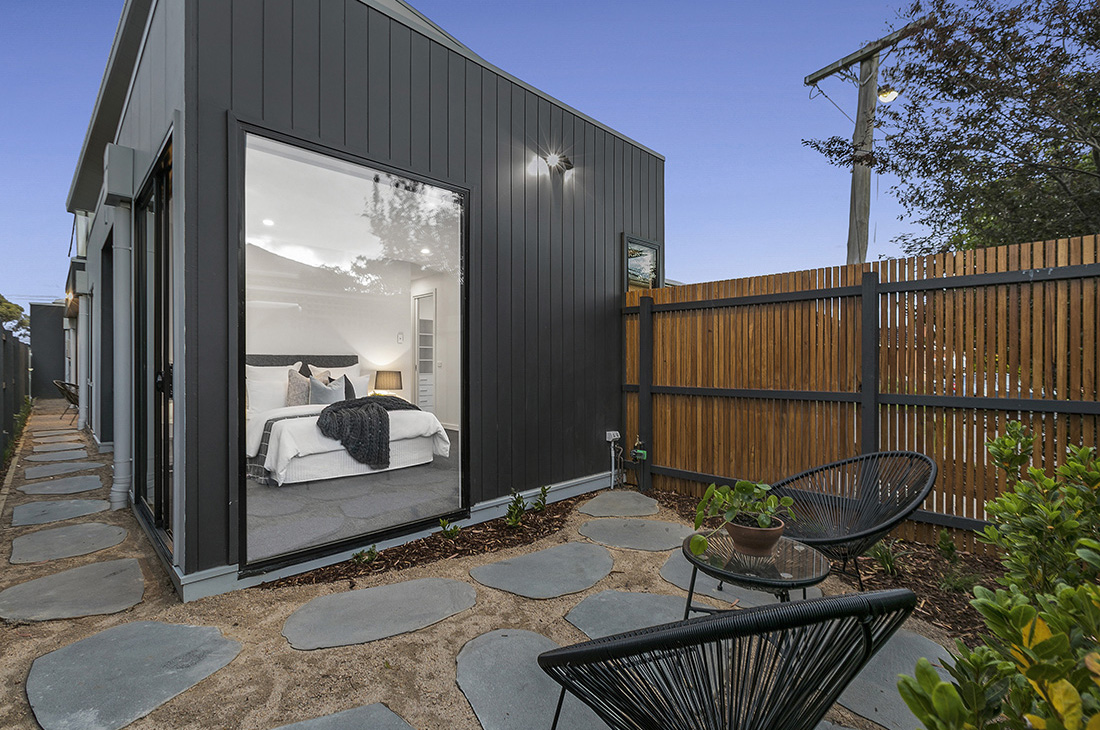 courtyard with black shiplap cladding