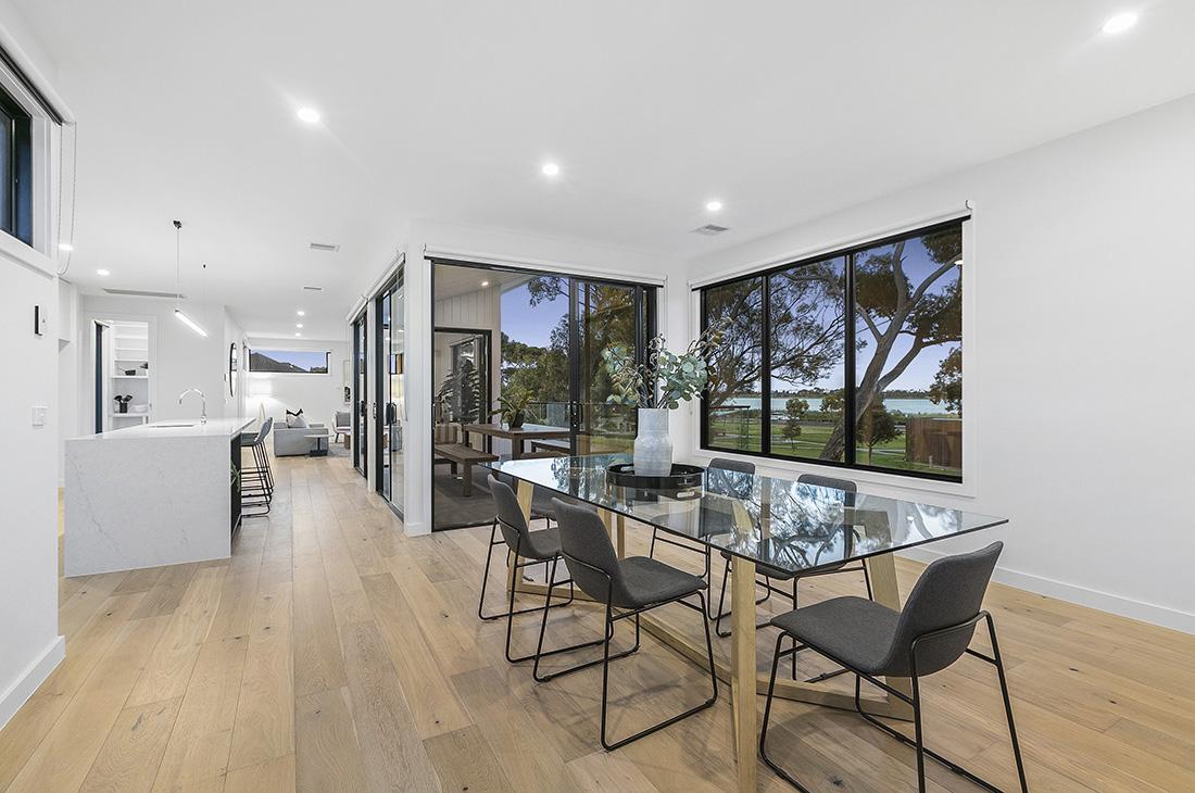reverse living open plan dining kitchen living overlooking parkland