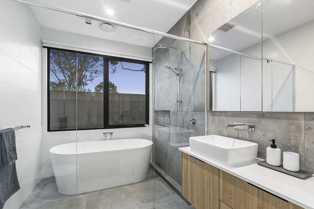 family bathroom with wet room bath and concrete tiles