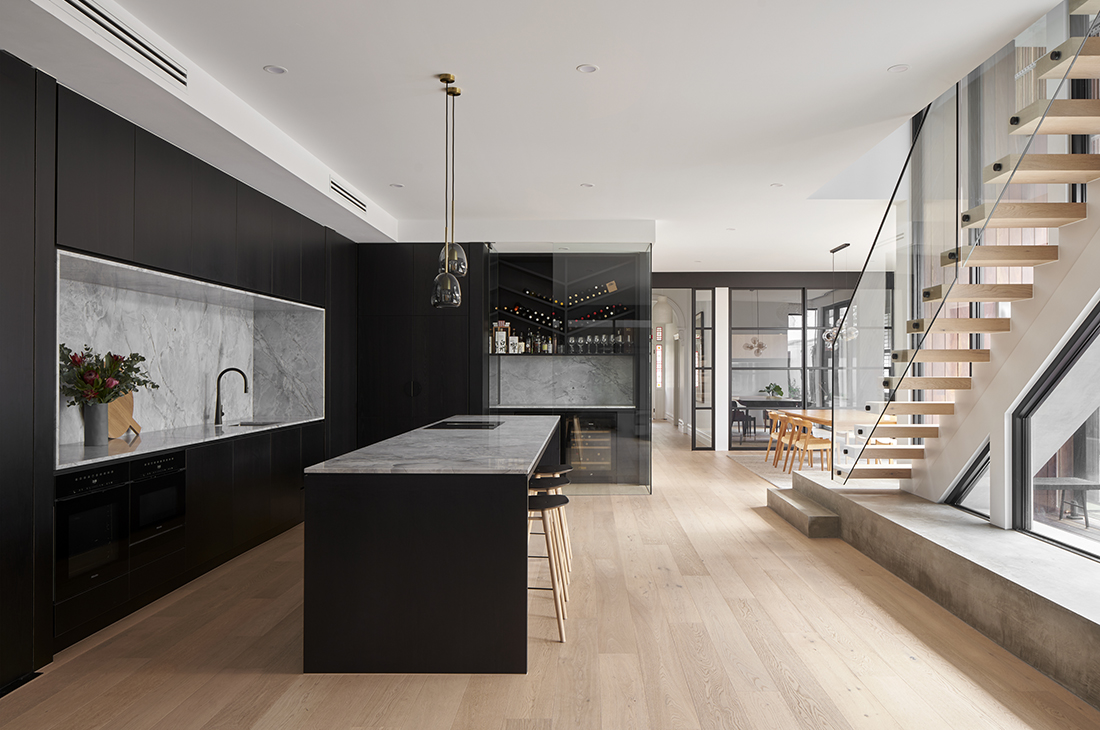 contemporary kitchen with black timber veneer and super white dolomite feature stair
