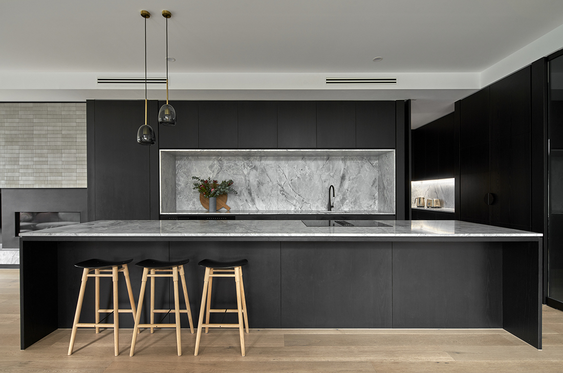 contemporary kitchen with black timber veneer and super white dolomite