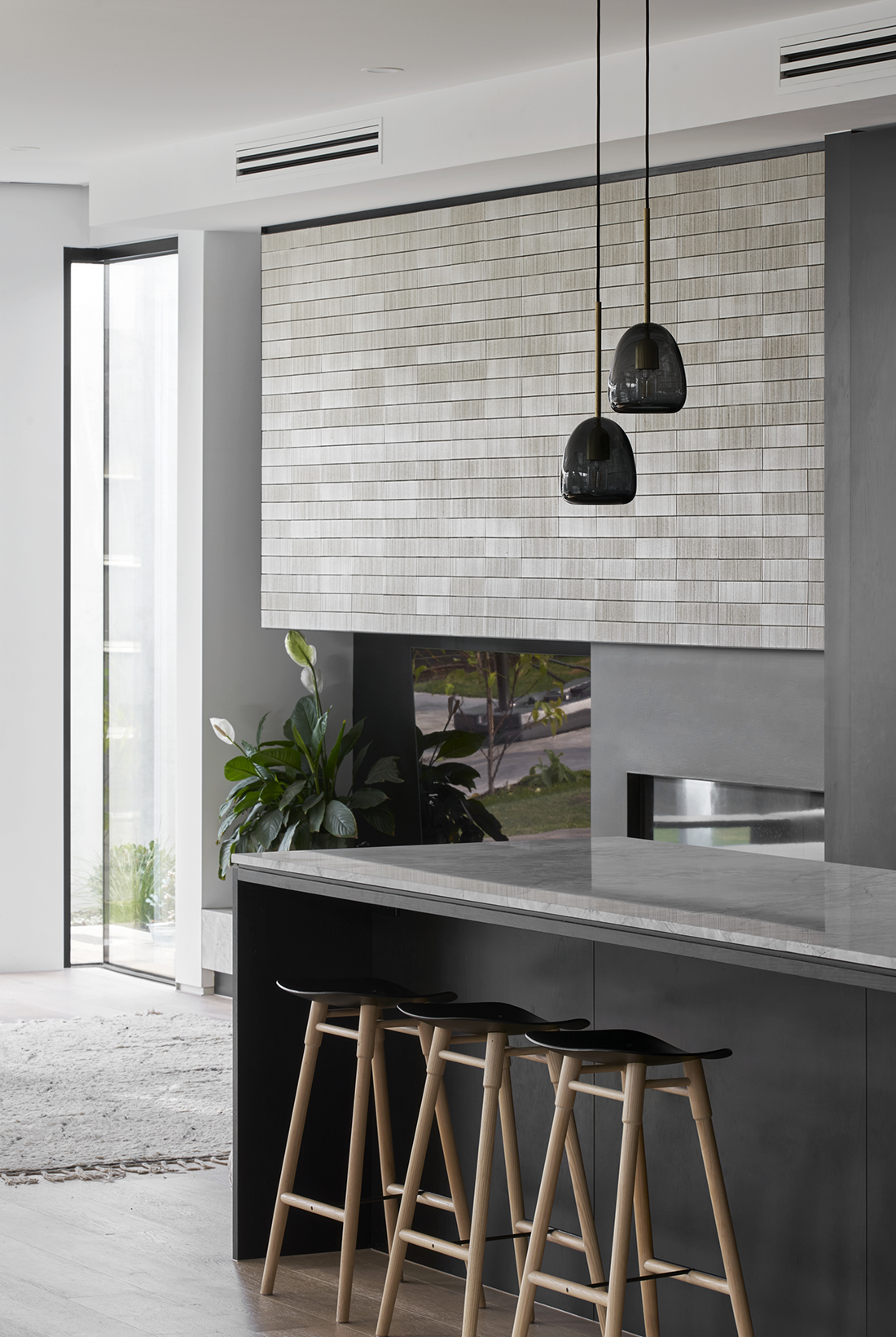 kitchen overlooking living room with feature tile