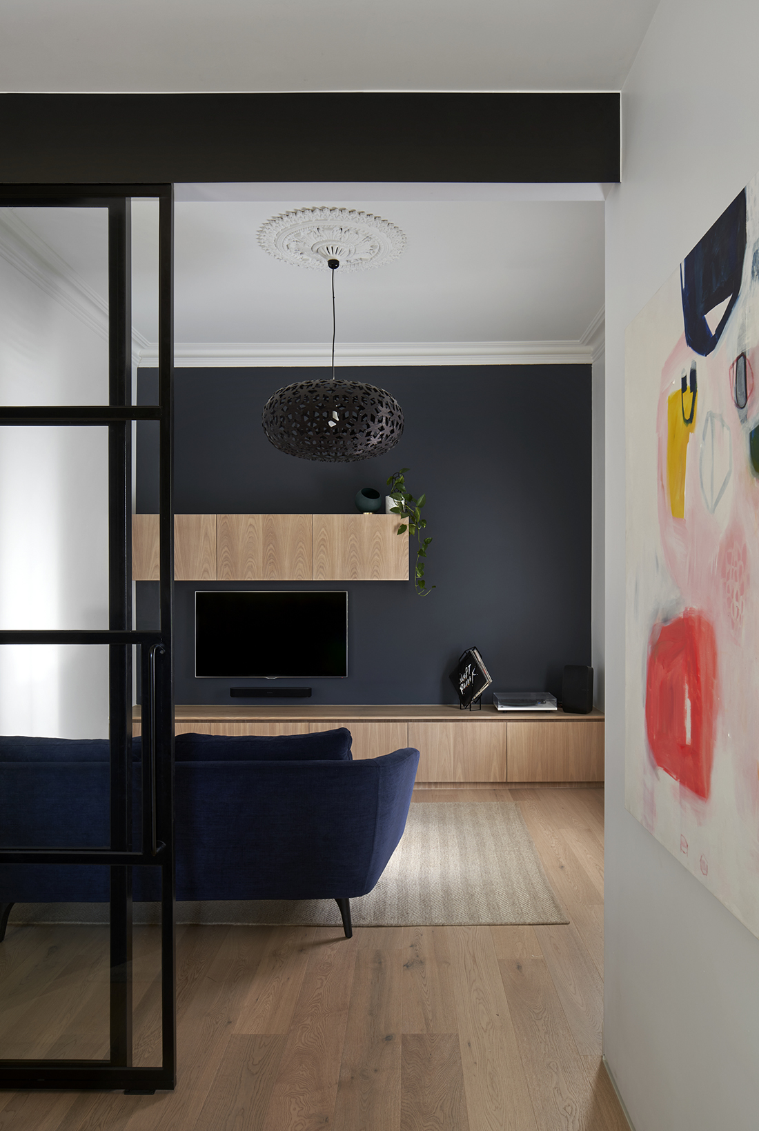 music room with squid ink feature wall steel windows