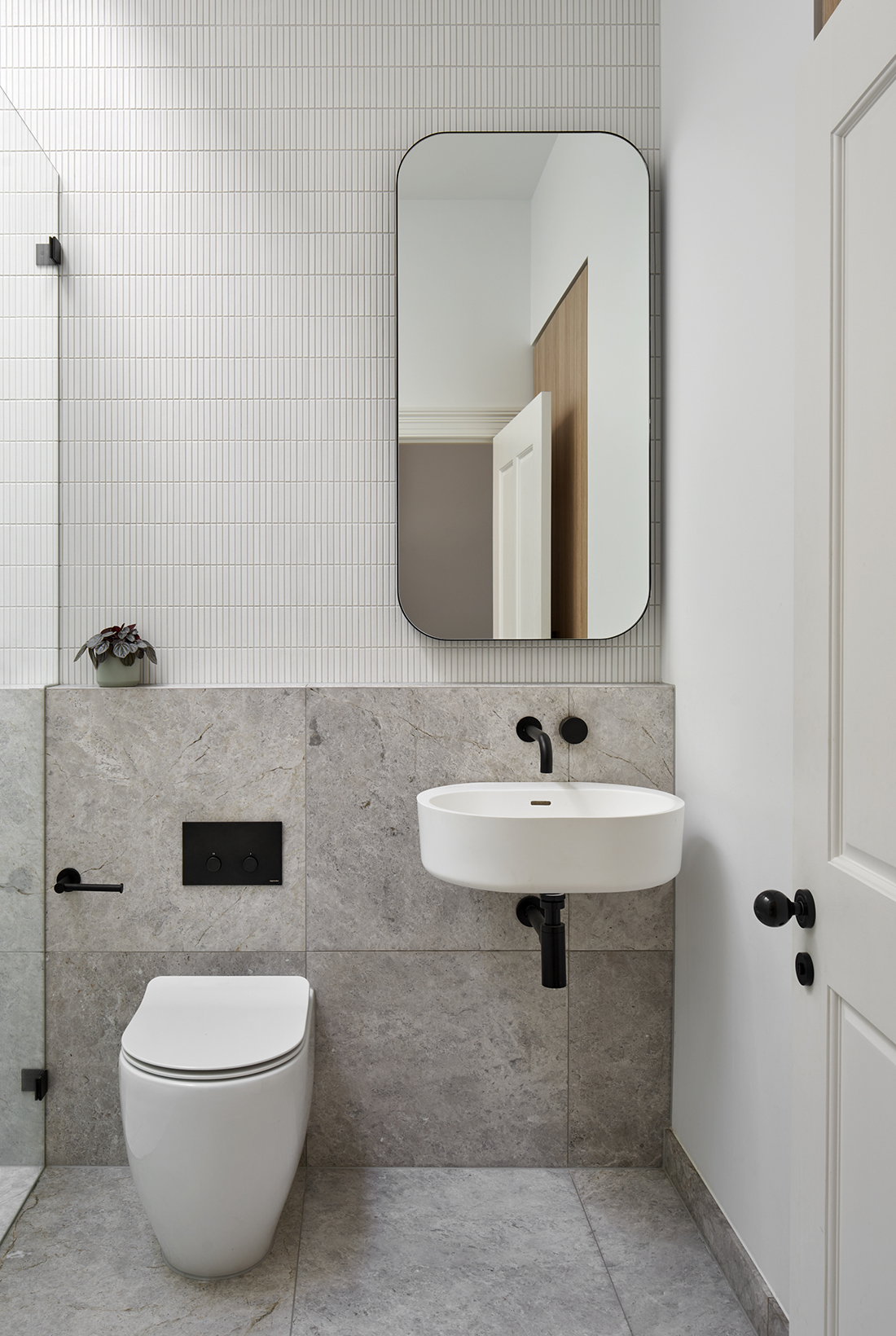 powder room with natural stone tiles and finger tiles