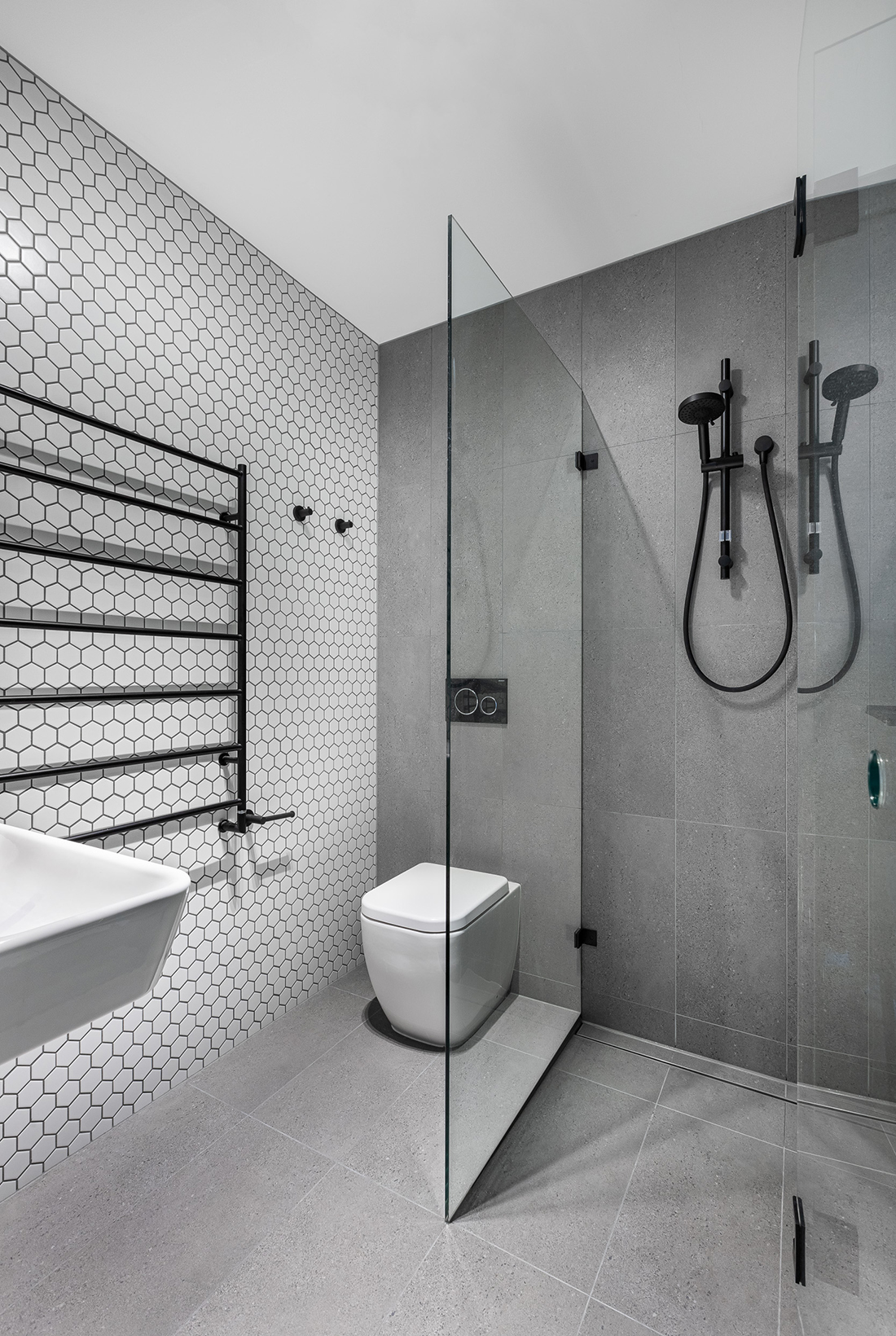 contemporary apartment within heritage listed building bathroom with hexagon feature tiles and black fixtures