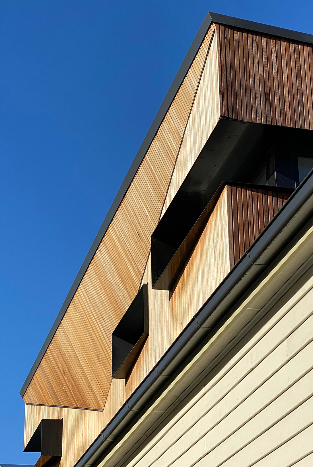contemporary timber batten extension to traditional weatherboard victorian home