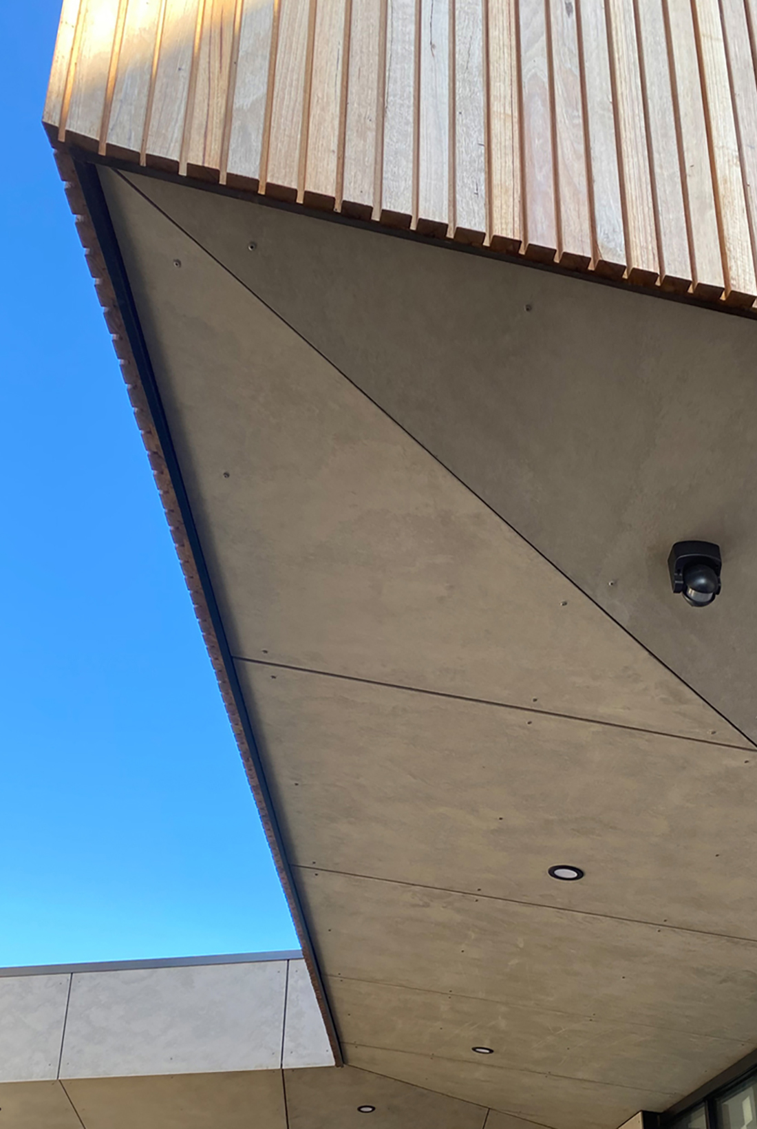 detail of contemporary timber batten cladding and cement sheet soffit