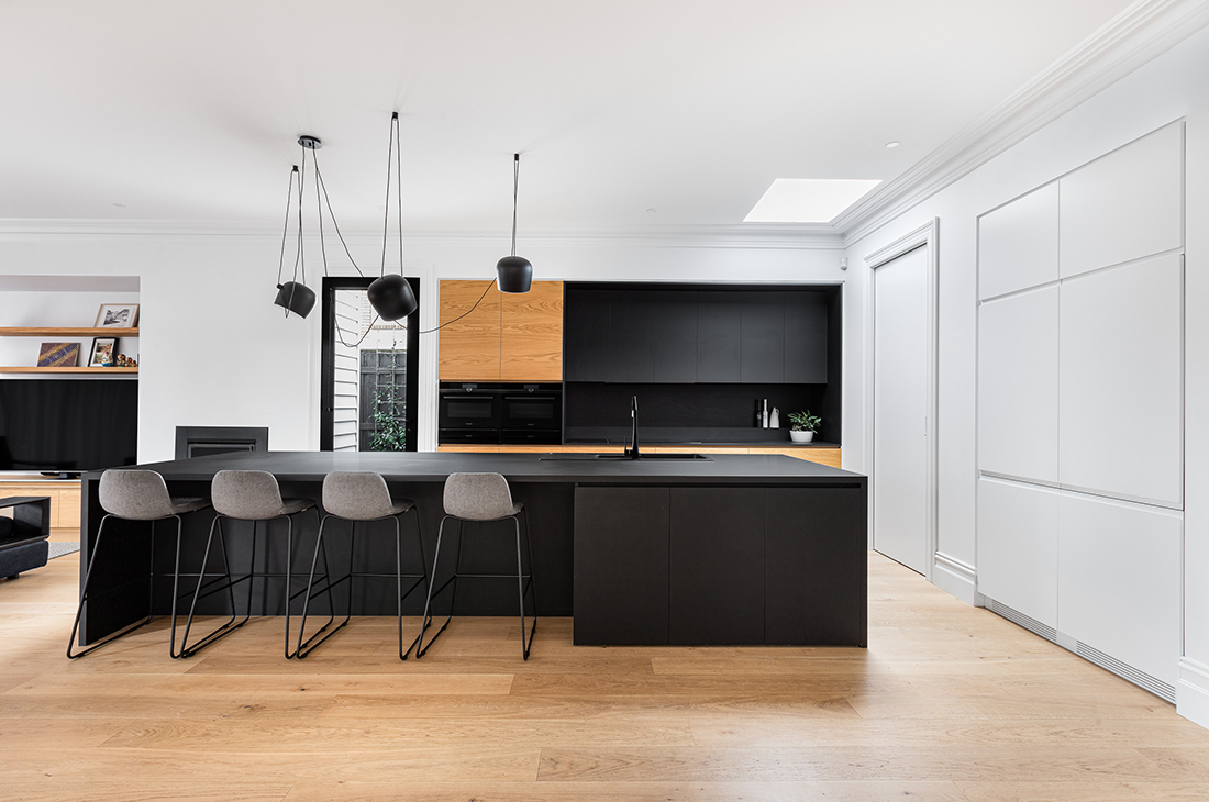 contemporary kitchen with black nanoparticle surface and oak veneer
